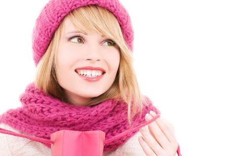 happy teenage girl in hat with pink shopping bags Stock Photo - 5772040