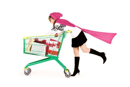 happy teenage girl with shopping cart over white Stock Photo - 5772002