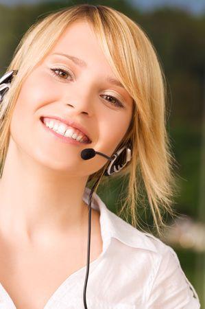 bright picture of friendly female helpline operator photo