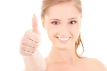 bright picture of lovely woman with thumbs up (focus on hand) photo