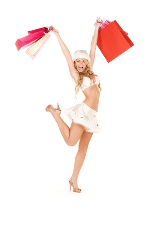 cheerful santa helper with shopping bags over white Stock Photo - 5772023