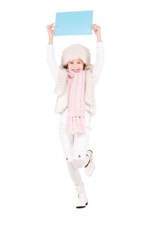 happy girl in winter hat with blank board Stock Photo - 5772021