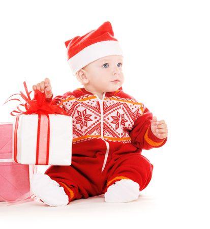 santa Helfer Baby mit Weihnachtsgeschenke over white