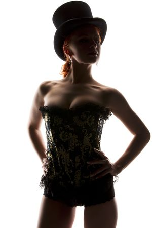 hat nude: silhouette backlight picture of sexy woman in corset