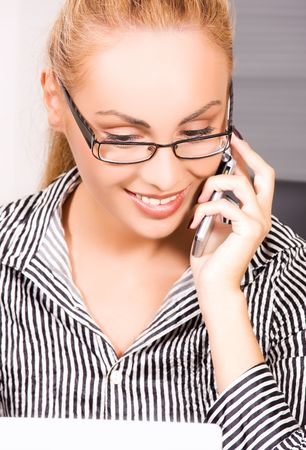 picture of lovely girl with cell phone in office Stock Photo - 5790396