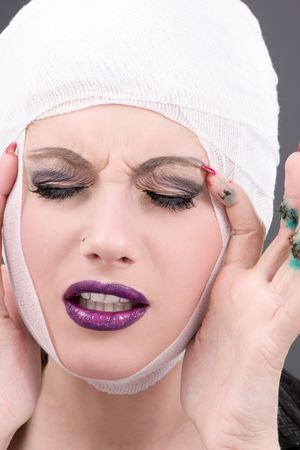 picture of suffering woman face over grey Stock Photo - 5813777