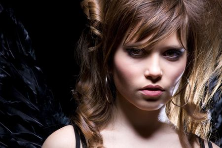 angel alone: picture of lovely girl with black angel wings Stock Photo