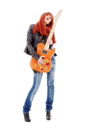 picture of lovely redhead girl with orange guitar photo