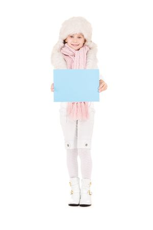 happy girl in winter hat with blank board Stock Photo - 5813723