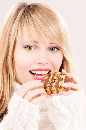 picture of happy teenage girl with cookie photo