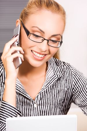picture of lovely girl with cell phone in office Stock Photo - 5829475