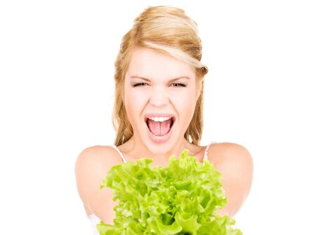picture of happy woman with lettuce over white photo