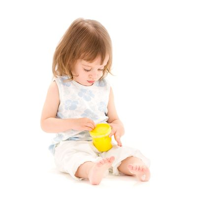 picture of little girl with yellow modelling foam over white Stock Photo - 5847682