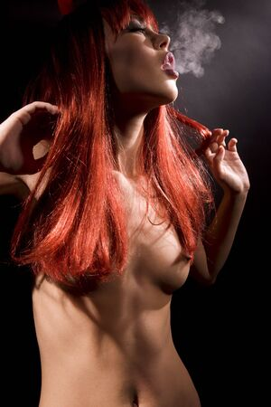 dark picture of smoking naked devil woman Stock Photo - 5847900