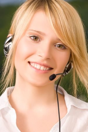 bright picture of friendly female helpline operator Stock Photo - 5847857
