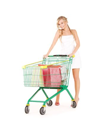 happy woman with shopping cart over white Stock Photo - 5847718