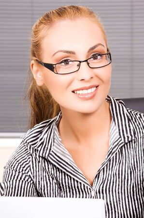 picture of lovely girl with computer in office photo