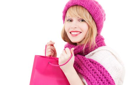 happy teenage girl in hat with pink shopping bags Stock Photo - 5847914