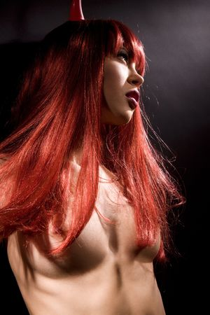dark picture of naked redhead devil woman Stock Photo - 5882385