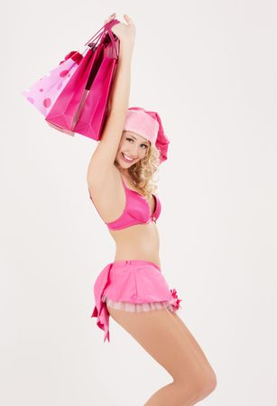 cheerful santa helper with pink shopping bags Stock Photo - 5882398