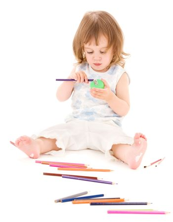 picture of little girl with color pencils over white photo