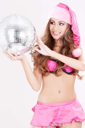 sexy santa helper in pink lingerie with disco ball photo