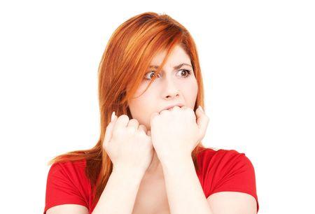 desperate: imagen de la mujer pelirroja infeliz m�s de blanco Foto de archivo