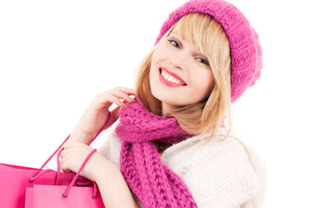 happy teenage girl in hat with pink shopping bags Stock Photo - 5902497