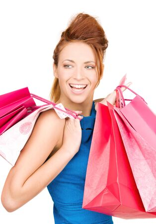 happy woman with shopping bags over white Stock Photo - 5912620