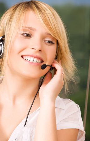 bright picture of friendly female helpline operator Stock Photo - 5912604