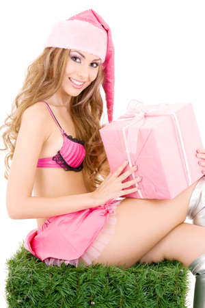 sexy santa helper with gift box over white photo