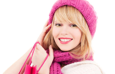 happy teenage girl in hat with pink shopping bags Stock Photo - 5912651