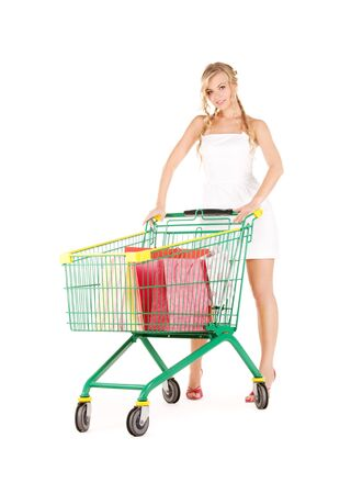 happy woman with shopping cart over white Stock Photo - 5932642