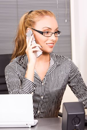 picture of lovely girl with cell phone in office Stock Photo - 5932665