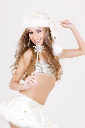 party dancer girl with magic wand in santa helper costume photo
