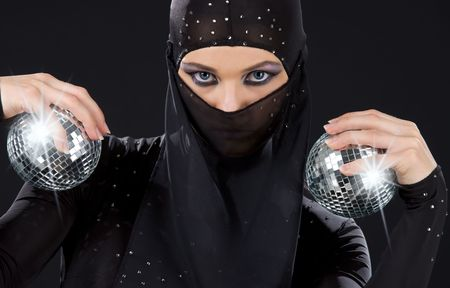 party dancer in ninja dress with disco balls photo