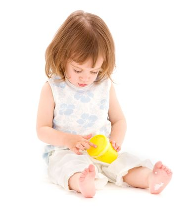 picture of little girl with yellow modelling foam over white Stock Photo - 5947451