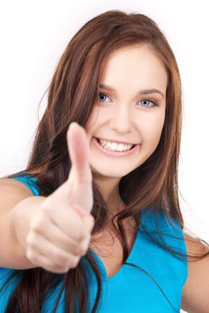 bright picture of lovely woman with thumbs up Stock Photo - 5947593