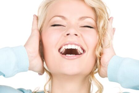 picture of happy screaming woman with hands over ears photo