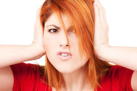 picture of unhappy redhead woman with hands on ears Stock Photo - 5947446