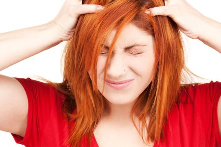 bad hair: picture of unhappy redhead woman over white