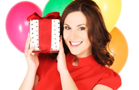happy woman with gift box and balloons photo