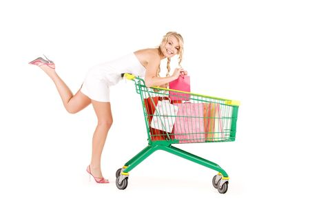 happy woman with shopping cart over white Stock Photo - 5947427