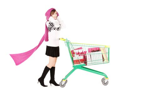 wooly: happy teenage girl with shopping cart over white