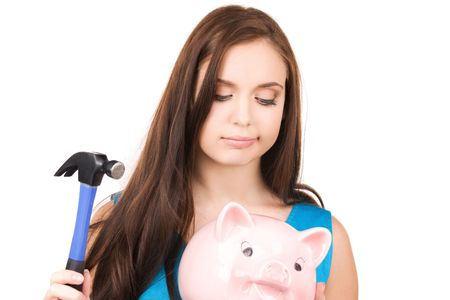 lovely teenage girl with piggy bank and hammer Stock Photo - 5947550