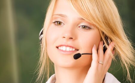 bright picture of friendly female helpline operator Stock Photo - 5947509