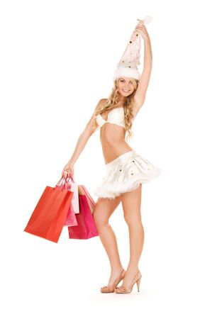cheerful santa helper with shopping bags over white Stock Photo - 5962318