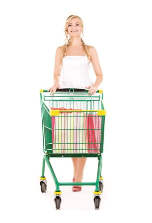 happy woman with shopping cart over white Stock Photo - 5962320
