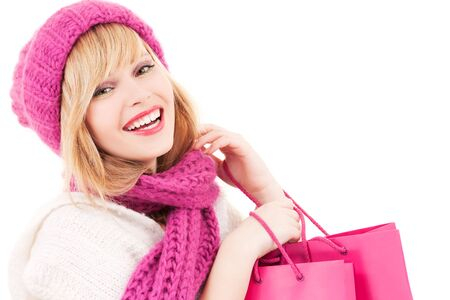 happy teenage girl in hat with pink shopping bags photo