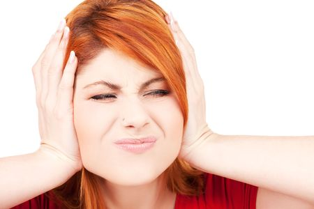 picture of unhappy redhead woman with hands on ears Stock Photo - 5962393